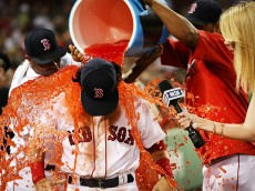 BOSTON, MA - AUGUST 09:  Andrew Benintendi #40 of the Boston Red Sox has sports drink dumped on him during a post game interview with NESN reporter Guerin Austin after the victory over the New York Yankees at Fenway Park on August 9, 2016 in Boston, Massachusetts.  (Photo by Adam Glanzman/Getty Images)