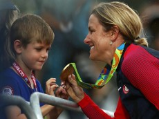 RIO DE JANEIRO, BRAZIL - AUGUST 10:  Gold medalist Kristin Armstrong of the United States shows her medal to her son Lucas William Savola after the medal ceremony for the Cycling Road Women's Individual Time Trial on Day 5 of the Rio 2016 Olympic Games at Pontal on August 10, 2016 in Rio de Janeiro, Brazil.  (Photo by Bryn Lennon/Getty Images)