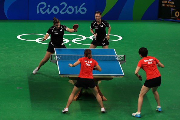 RIO DE JANEIRO, BRAZIL - AUGUST 16: Petrissa Solja and Xiaona Shan of Germany play a doubles match against Shiwen Liu and Ning Ding of China in the Women's Team Gold Medal Team Match between China and Germany on Day 11 of the Rio 2016 Olympic Games at Riocentro - Pavilion 3 on August 16, 2016 in Rio de Janeiro, Brazil. (Photo by Mike Ehrmann/Getty Images)