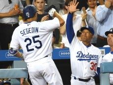LOS ANGELES, CA - AUGUST 14: Rob Segedin #25 of the Los Angeles Dodgers is greeted by manager Dave Roberts #30 after a solo home run in the second inning of the game against the San Francisco Giants at Dodger Stadium on August 23, 2016 in Los Angeles, California. (Photo by Jayne Kamin-Oncea/Getty Images)