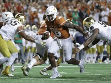 AUSTIN, TX - SEPTEMBER 04:  (EDITORS NOTE: Retransmission with alternate crop.) Tyrone Swoopes #18 of the Texas Longhorns rushes for the game-winning touchdown in the second overtime against the Notre Dame Fighting Irish at Darrell K. Royal-Texas Memorial Stadium on September 4, 2016 in Austin, Texas.  (Photo by Ronald Martinez/Getty Images)