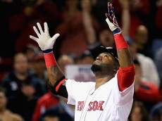 BOSTON, MA - SEPTEMBER 15:  David Ortiz #34 of the Boston Red Sox celebrates after hitting a home run against the New York Yankees during the eighth inning at Fenway Park on September 15, 2016 in Boston, Massachusetts.  (Photo by Maddie Meyer/Getty Images)