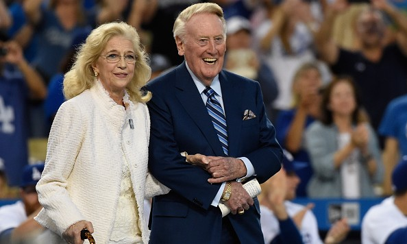 LOS ANGELES, CA - SEPTEMBER 23:  Vin Scully and his wife Sandra Hunt walk onto the field during a retirement ceremony in his honor before the game at Dodger Stadium on September 23, 2016 in Los Angeles, California.  (Photo by Lisa Blumenfeld/Getty Images)