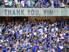 LOS ANGELES, CA - SEPTEMBER 25:  Fans cheer as Los Angeles Dodgers announcer Vin Scully speaks to fans during his final home game as he retires at the end of his 67th season after a 4-3 win over the Colorado Rockies at Dodger Stadium on September 25, 2016 in Los Angeles, California.  (Photo by Harry How/Getty Images)