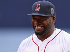 BOSTON, MA - OCTOBER 02:  David Ortiz #34 of the Boston Red Sox smiles during the pregame ceremony to honor his retirement before his last regular season home game at Fenway Park on October 2, 2016 in Boston, Massachusetts.  (Photo by Maddie Meyer/Getty Images)