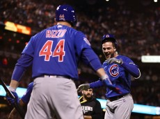 SAN FRANCISCO, CA - OCTOBER 10:  Kris Bryant #17 of the Chicago Cubs celebrates with Anthony Rizzo #44 after hitting a two-run home run in the ninth inning against the San Francisco Giants during Game Three of their National League Division Series against the Chicago Cubs at AT&T Park on October 10, 2016 in San Francisco, California.  (Photo by Ezra Shaw/Getty Images)