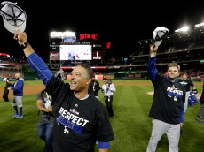 WASHINGTON, DC - OCTOBER 13: Manager Dave Roberts #30 of the Los Angeles Dodgers celebrates after winning game five of the National League Division Series over the Washington Nationals 4-3 at Nationals Park on October 13, 2016 in Washington, DC. (Photo by Rob Carr/Getty Images)