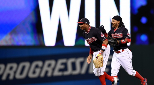 CLEVELAND, OH - OCTOBER 14:  Jose Ramirez #11 and Rajai Davis #20 of the Cleveland Indians celebrate after defeating the Toronto Blue Jays with a score of 2 to 0 in game one of the American League Championship Series at Progressive Field on October 14, 2016 in Cleveland, Ohio.  (Photo by Jason Miller/Getty Images)