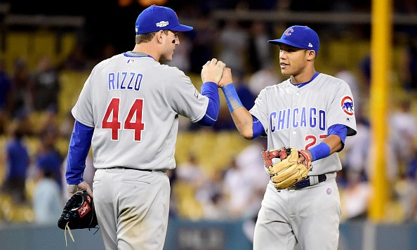 LOS ANGELES, CA - OCTOBER 19:  Anthony Rizzo #44 and Addison Russell #27 of the Chicago Cubs celebrate their 10-2 victory against the Los Angeles Dodgers in game four of the National League Championship Series at Dodger Stadium on October 19, 2016 in Los Angeles, California.  (Photo by Harry How/Getty Images)