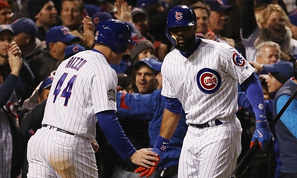 CHICAGO, IL - OCTOBER 30:  Anthony Rizzo #44 of the Chicago Cubs (L) is congratulated by Jason Heyward #22 after Rizzo scored a run in the fourth inning against the Cleveland Indians in Game Five of the 2016 World Series at Wrigley Field on October 30, 2016 in Chicago, Illinois.  (Photo by Elsa/Getty Images)