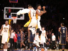 LOS ANGELES, CA - JANUARY 04:  Nick Young #0 and Jeremy Lin #17 of the Los Angeles Lakers jump as they celebrate after the game against the Indiana Pacers at Staples Center on January 4, 2015 in Los Angeles, California.The Lakers won 88-87.  NOTE TO USER: User expressly acknowledges and agrees that, by downloading and or using this photograph, User is consenting to the terms and conditions of the Getty Images License Agreement.  (Photo by Stephen Dunn/Getty Images)