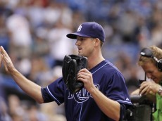 ST. PETERSBURG, FL - SEPTEMBER 6:  Pitcher Drew Smyly #33 of the Tampa Bay Rays celebrates with teammates as he enters the dugout after striking out Adam Jones of the Baltimore Orioles to end the top of the fifth inning of a game on September 6, 2014 at Tropicana Field in St. Petersburg, Florida.  (Photo by Brian Blanco/Getty Images)