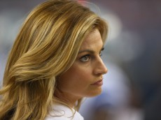 ARLINGTON, TX - SEPTEMBER 07:  Erin Andrews watches a game between the San Francisco 49ers and the Dallas Cowboys at AT&T Stadium on September 7, 2014 in Arlington, Texas.  (Photo by Ronald Martinez/Getty Images)