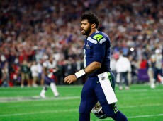 GLENDALE, AZ - FEBRUARY 01:  Russell Wilson #3 of the Seattle Seahawks looks on after his pass is intercepted by Malcolm Butler #21 of the New England Patriots late in the fourth quarter against the New England Patriots during Super Bowl XLIX at University of Phoenix Stadium on February 1, 2015 in Glendale, Arizona.  (Photo by Kevin C. Cox/Getty Images)
