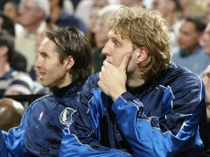 PORTLAND, OR - MAY 2:  Dirk Nowitzki #41 and Steve Nash #13 of the Dallas Mavericks look on in Game six of the Western Conference Quarterfinals during the 2003 NBA Playoffs against the Portland Trail Blazers at The Rose Garden on May 2, 2003 in Portland, Oregon.  The Trail Blazers won 125-103.  NOTE TO USER: User expressly acknowledges and agrees that, by downloading and/or using this Photograph, User is consenting to the terms and conditions of the Getty Images License Agreement.(Photo by Jonathan Ferrey/Getty Images)