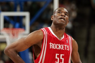 DENVER - APRIL 17:  Dikembe Mutombo #55 of Houston Rockets looks up at the clock in the fourth quarter against the Denver Nuggets on April 17, 2006 at the Pepsi Center in Denver, Colorado. The Rockets won 86-83.  NOTE TO USER: USER expressly acknowledges and agrees that, by downloading and or using this photograph, User is consenting to the terms and conditions of the Getty Images License Agreement.  (Photo by Brian Bahr/Getty Images)