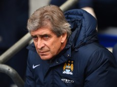 MANCHESTER, ENGLAND - MARCH 22:  Manuel Pellegrini manager of Manchester City looks on during the Barclays Premier League match between Manchester City and Fulham at Etihad Stadium on March 22, 2014 in Manchester, England.  (Photo by Michael Regan/Getty Images)