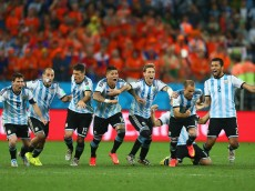 SAO PAULO, BRAZIL - JULY 09:  Lionel Messi, Pablo Zabaleta, Martin Demichelis, Marcos Rojo, Lucas Biglia, Javier Mascherano, Rodrigo Palacio and Ezequiel Garay of Argentina celebrate defeating the Netherlands in a shootout during the 2014 FIFA World Cup Brazil Semi Final match between the Netherlands and Argentina at Arena de Sao Paulo on July 9, 2014 in Sao Paulo, Brazil.  (Photo by Ronald Martinez/Getty Images)