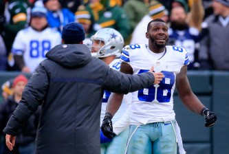 GREEN BAY, WI - JANUARY 11:  Dez Bryant #88 of the Dallas Cowboys waits for a replay on a call late in the fourth quarter against the Green Bay Packers during the 2015 NFC Divisional Playoff game at Lambeau Field on January 11, 2015 in Green Bay, Wisconsin.  (Photo by Rob Carr/Getty Images)