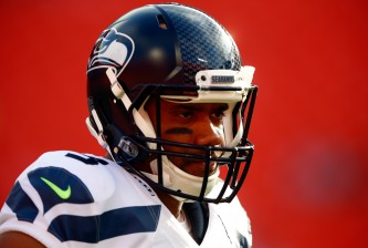 KANSAS CITY, MO - AUGUST 21:  Quarterback Russell Wilson #3 of the Seattle Seahawks warms up prior to the preaseason game against the Kansas City Chiefs at Arrowhead Stadium on August 21, 2015 in Kansas City, Missouri.  (Photo by Jamie Squire/Getty Images)