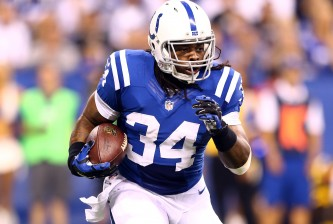 INDIANAPOLIS, IN - SEPTEMBER 15: Running back Trent Richardson #34 of the Indianapolis Colts carries the ball against the Philadelphia Eagles during a game at Lucas Oil Stadium on September 15, 2014 in Indianapolis, Indiana.  (Photo by Andy Lyons/Getty Images)