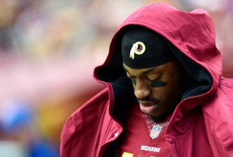 LANDOVER, MD - NOVEMBER 16: Quarterback Robert Griffin III #10 of the Washington Redskins of the Washington Redskins looks on in the second half of a game against the Tampa Bay Buccaneers at FedExField on November 16, 2014 in Landover, Maryland.  (Photo by Patrick McDermott/Getty Images)