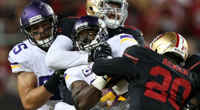 SANTA CLARA, CA - SEPTEMBER 14: Adrian Peterson #28 of the Minnesota Vikings is hit by Aaron Lynch #59 and Kenneth Acker #20 of the San Francisco 49ers during their NFL game at Levi's Stadium on September 14, 2015 in Santa Clara, California. (Photo by Ezra Shaw/Getty Images)
