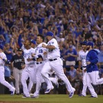 KANSAS CITY, MO - SEPTEMBER 24:  Members of the Kansas City Royals celebrate after clinching the American League Central Division title at Kauffman Stadium on September 24, 2015 in Kansas City, Missouri. The Royals beat the Seattle Mariners 10-4. (Photo by Ed Zurga/Getty Images)