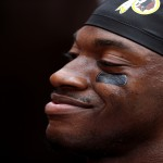 LANDOVER, MD - AUGUST 20: Quarterback Robert Griffin III #10 of the Washington Redskins smiles to fans prior to a preseason game against the Detroit Lions at FedEx Field on August 20, 2015 in Landover, Maryland.  (Photo by Matt Hazlett/Getty Images)