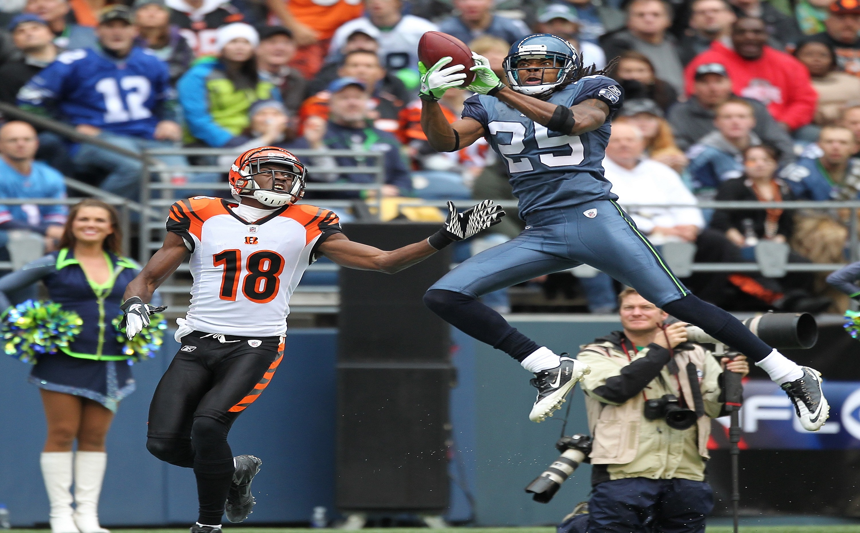 SEATTLE - OCTOBER 30:  Cornerback Richard Sherman #25 of the Seattle Seahawks makes an interception against A.J. Green #18 of the Cincinnati Bengals at CenturyLink Field on October 30, 2011 in Seattle, Washington. The Bengals defeated the Seahawks 34-12.(Photo by Otto Greule Jr/Getty Images)