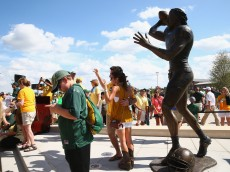 WACO, TX - AUGUST 31:  Fans look at a statue of former Baylor Bears quarterback Robert Griffin III at McLane Stadium on August 31, 2014 in Waco, Texas.  (Photo by Ronald Martinez/Getty Images)