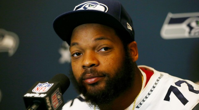 JERSEY CITY, NJ - JANUARY 30:  Michael Bennett #72 of the Seattle Seahawks addresses the media during Super Bowl XLVIII media availability at the Westin Hotel January 30, 2014 in Jersey City, New Jersey. The Denver Broncos and Seattle Seahawks will meet in Super Bowl XLVIII at Metlife Stadium on February 2, 2014.  (Photo by Elsa/Getty Images)