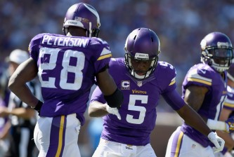 MINNEAPOLIS, MN - SEPTEMBER 27: Adrian Peterson #28 and Teddy Bridgewater #5 of the Minnesota Vikings celebrate a touchdown against the San Diego Chargers during the second quarter of the game on September 27, 2015 at TCF Bank Stadium in Minneapolis, Minnesota. (Photo by Hannah Foslien/Getty Images)