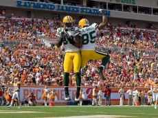 TAMPA, FL - NOVEMBER 08:  Receivers James Jones #89 and Greg Jennings #85 of the Green Bay Packers celebrate Jones' first quarter touchdown against the Tampa Bay Buccaneers during the game at Raymond James Stadium on November 8, 2009 in Tampa, Florida.  (Photo by J. Meric/Getty Images)