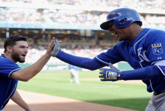 MINNEAPOLIS, MN - OCTOBER 4: Eric Hosmer #35 of the Kansas City Royals congratulates teammate Salvador Perez #13 on a two-run home run against the Minnesota Twins during the third inning of the game on October 4, 2015 at Target Field in Minneapolis, Minnesota. (Photo by Hannah Foslien/Getty Images)
