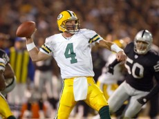 OAKLAND, CA - DECEMBER 22:  Brett Favre #4 of the Green Bay Packers passes against the Oakland Raiders December 22, 2003  at the Network Associates Coliseum in Oakland, California.  (Photo by Jed Jacobsohn/Getty Images)