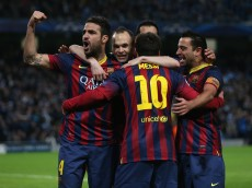 MANCHESTER, ENGLAND - FEBRUARY 18:  Lionel Messi of Barcelona celebrates scoring the opening goal from a penalty kick with his team-mates during the UEFA Champions League Round of 16 first leg match between Manchester City and Barcelona at the Etihad Stadium on February 18, 2014 in Manchester, England.  (Photo by Clive Brunskill/Getty Images)
