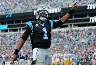 CHARLOTTE, NC - NOVEMBER 22:  Cam Newton #1 of the Carolina Panthers celebrates a touchdown against the Washington Redskins in the 1st quarter during their game at Bank of America Stadium on November 22, 2015 in Charlotte, North Carolina.  (Photo by Streeter Lecka/Getty Images)