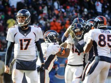 CHICAGO, IL - NOVEMBER 22:  Quarterback Brock Osweiler #17 of the Denver Broncos reacts as  Cody Latimer #14 celebrates with teammates after scoring against the Chicago Bears in the fourth quarter at Soldier Field on November 22, 2015 in Chicago, Illinois.  (Photo by David Banks/Getty Images)