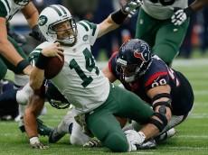 HOUSTON, TX - NOVEMBER 22:  Ryan Fitzpatrick #14 of the New York Jets is sacked by J.J. Watt #99 of the Houston Texans at NRG Stadium on November 22, 2015 in Houston, Texas.  (Photo by Bob Levey/Getty Images)