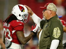 GLENDALE, AZ - NOVEMBER 22: Head coach Bruce Arians of the Arizona Cardinals pats running back Chris Johnson #23 (left) on the helmet before the NFL game against the Cincinnati Bengals at the University of Phoenix Stadium on November 22, 2015 in Glendale, Arizona.  (Photo by Christian Petersen/Getty Images)