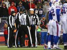 FOXBORO, MA - NOVEMBER 23:  Referees gather during the third quarter of a game between the New England Patriots and the Buffalo Bills at Gillette Stadium on November 23, 2015 in Foxboro, Massachusetts.  (Photo by Jim Rogash/Getty Images)