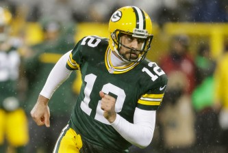 GREEN BAY, WI - NOVEMBER 26:  Quarterback  Aaron Rodgers #12 of the Green Bay Packers warms up prior to the NFL game against the Chicago Bears at Lambeau Field on November 26, 2015 in Green Bay, Wisconsin.  (Photo by Mike McGinnis/Getty Images)