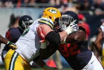 CHICAGO, IL - SEPTEMBER 13:   Pernell McPhee #92 of the Chicago Bears rushes against  Bryan Bulaga #75 of the Green Bay Packers in the first half at Soldier Field on September 13, 2015 in Chicago, Illinois.  (Photo by Jonathan Daniel/Getty Images)