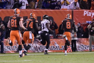CLEVELAND, OH - NOVEMBER 30:  Will Hill #33 of the Baltimore Ravens returns a blocked field goal for a touchdown in front of Jim Dray #81, Cameron Erving #74 and Andy Lee #8 of the Cleveland Browns during the fourth quarter at FirstEnergy Stadium on November 30, 2015 in Cleveland, Ohio. Baltimore won the game 33-27.  (Photo by Jason Miller/Getty Images)