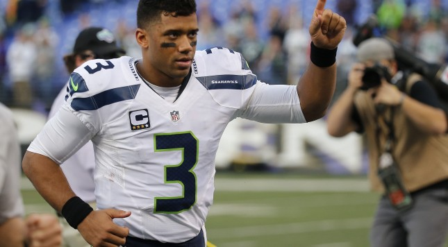 BALTIMORE, MD - DECEMBER 13: Quarterback Russell Wilson #3 of the Seattle Seahawks runs off the field after defeating the Baltimore Ravens 35-6 at M&T Bank Stadium on December 13, 2015 in Baltimore, Maryland. (Photo by Rob Carr/Getty Images)