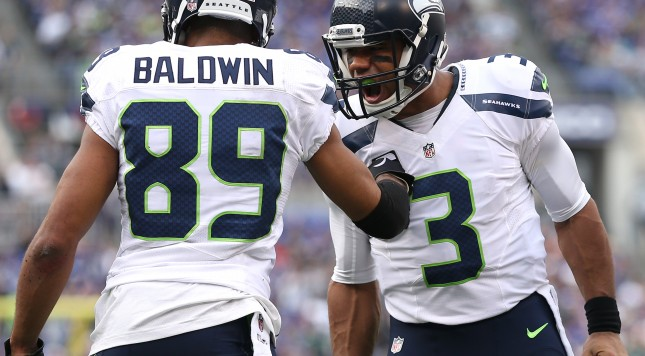 BALTIMORE, MD - DECEMBER 13: Quarterback Russell Wilson #3 of the Seattle Seahawks celebrates a teammates touchdown against the Baltimore Ravens at M&T Bank Stadium on December 13, 2015 in Baltimore, Maryland. (Photo by Patrick Smith/Getty Images)