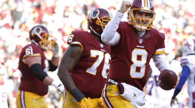 LANDOVER, MD - DECEMBER 20: Quarterback Kirk Cousins #8 of the Washington Redskins celebrates after scoring a second quarter touchdown against the Buffalo Bills at FedExField on December 20, 2015 in Landover, Maryland. (Photo by Matt Hazlett/Getty Images)
