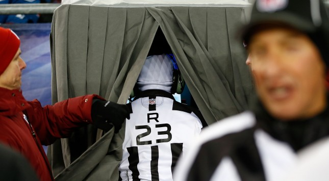 FOXBORO, MA - DECEMBER 30: Referee Jerome Boger looks at the screen in the instant replay booth during the game between the Miami Dolphins and the New England Patriots at Gillette Stadium on December 30, 2012 in Foxboro, Massachusetts. (Photo by Jared Wickerham/Getty Images)