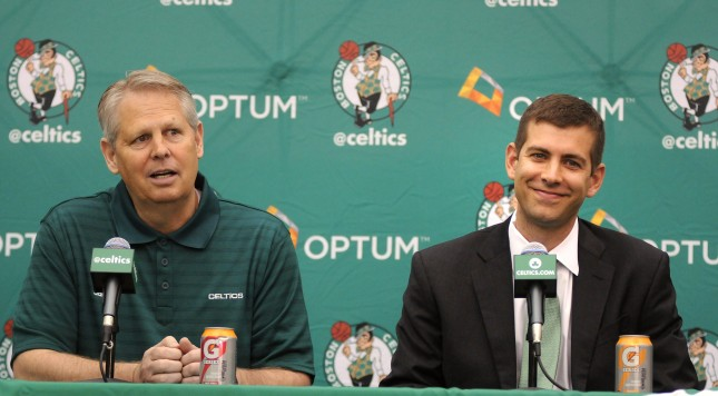 WALTHAM, MA - JULY 5: New Boston Celtics head coach Brad Stevens (R) is introduced to the media by President of Basketball Operations Danny Ainge July 5, 2013 in Waltham, Massachusetts. Stevens was hired away from Butler University where he led the Bulldogs to two back to back national championship game appearances in 2010, and 2011.  (Photo by Darren McCollester/Getty Images)